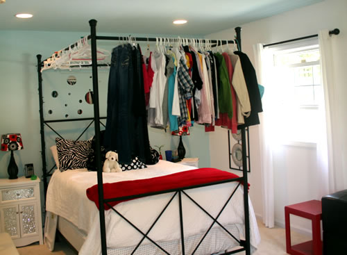clothes hanging on canopy bed