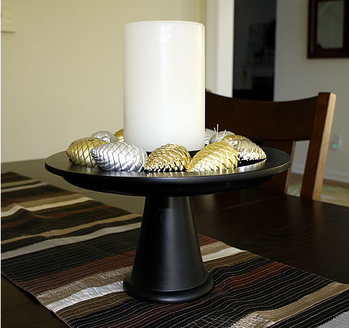 candle holiday centerpiece on cake plate
