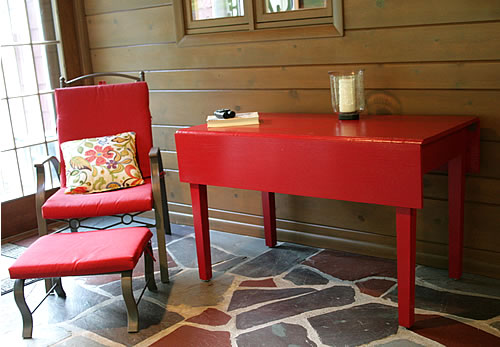 refinished red table at home in the sun room