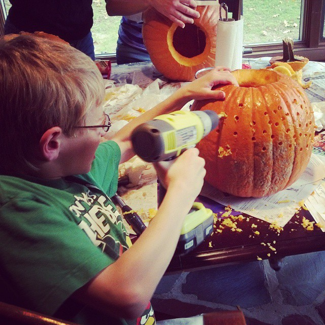 carving pumpkin with power drill