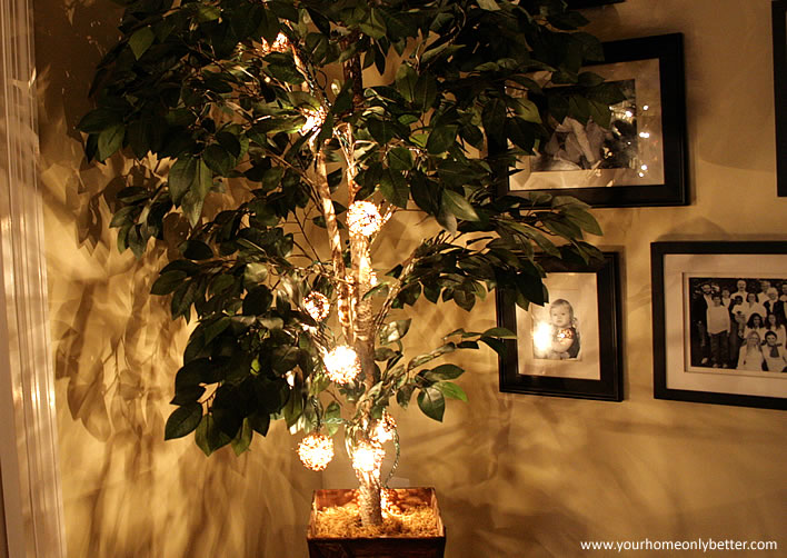 holiday string lights in trees and plants #diy #decor #yourhomeonlybetter