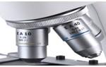 Revólver: Contém o sistema de lentes objetivas.