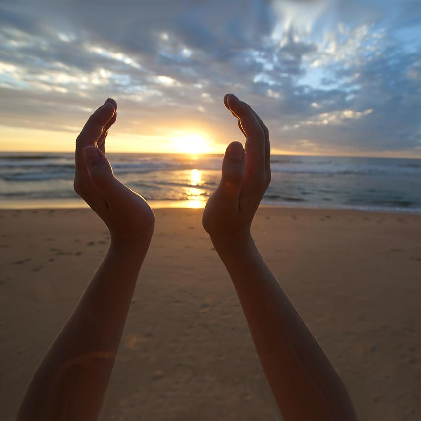 Hands Holding the Sunrise