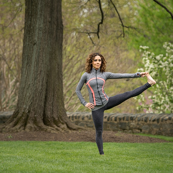 Kathy Jalali Extended Tree Pose in the Grass