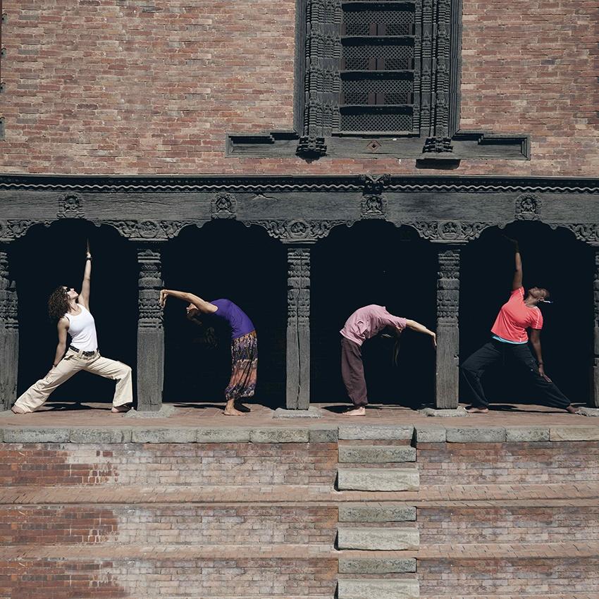 Yoga Poses Between Pillars in Nepal