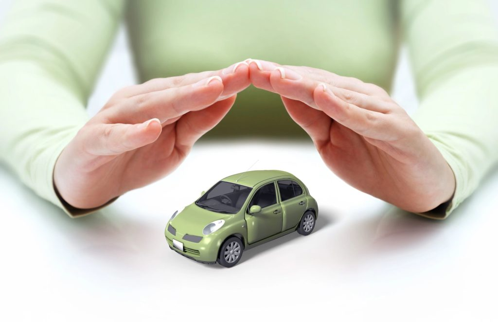 A woman's hands hovering protectively over a toy car