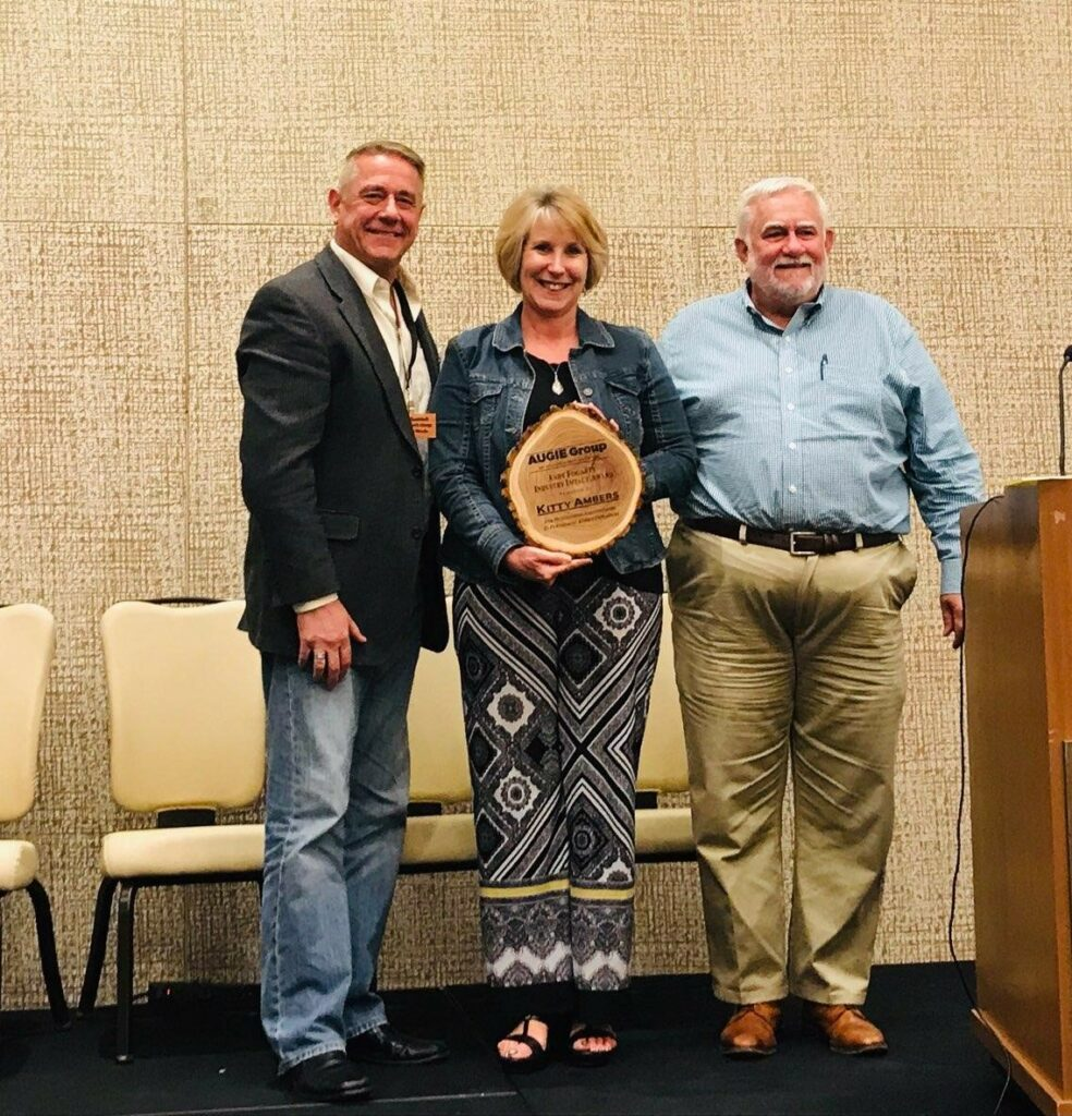 Mike Skeele, AUGIE Vice Chair; Kitty Ambers, Award Recipient; Jim Armitage, AUGIE Chair