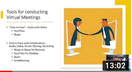 Powerpoint slide of 2 people shaking hands from a computer screen