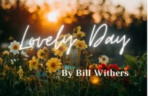 "Picture of flowers/sunset with title ""Lovely Day"" by Bill Withers"