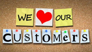 "Sign that says ""We ""heart"" our customers"