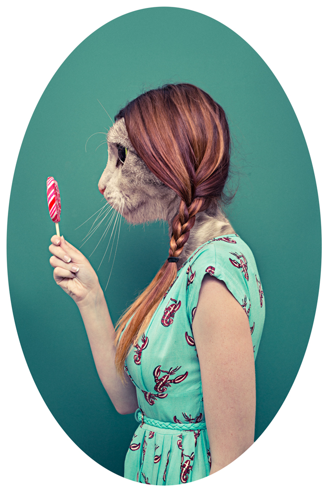 Girl in summer dress holding a lollypop with a cat as a head