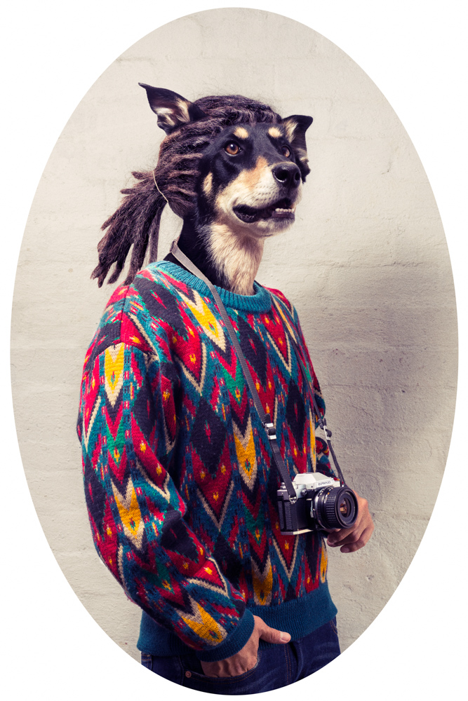 hipster wearing a 80's jumper with a dog head and dreadlocks