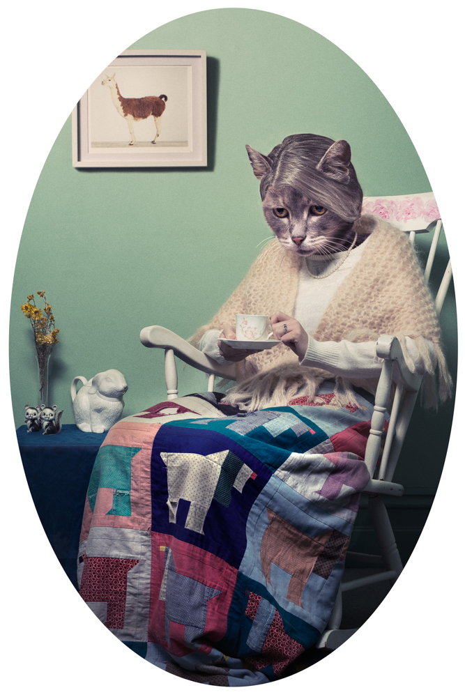 old lady sitting in rocker holding a cup of tea with a cat as a head