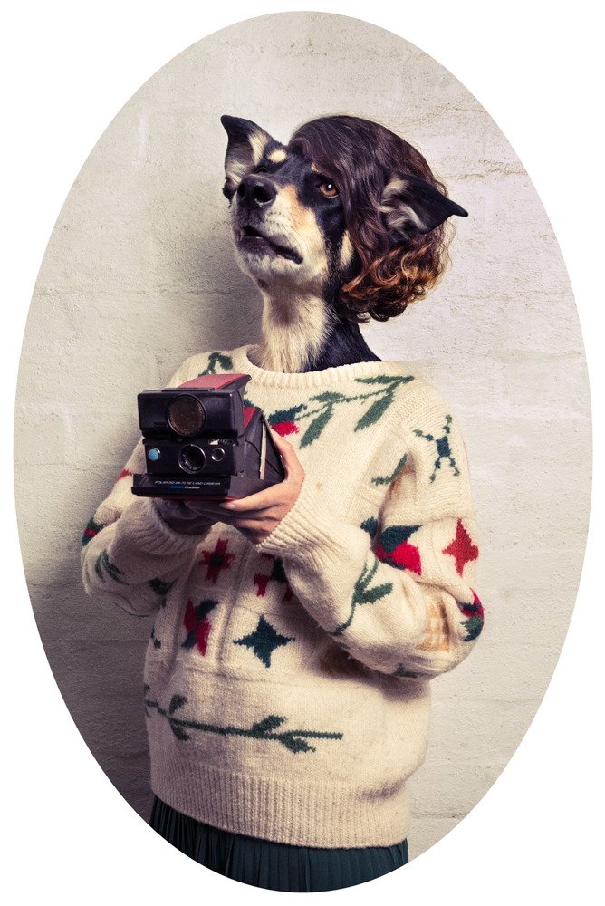 hipster holding a polaroid camera with a dog head