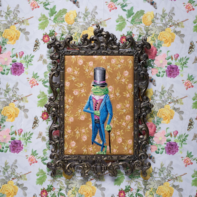 Embroidered Victorian dressed Frog in vintage frame.