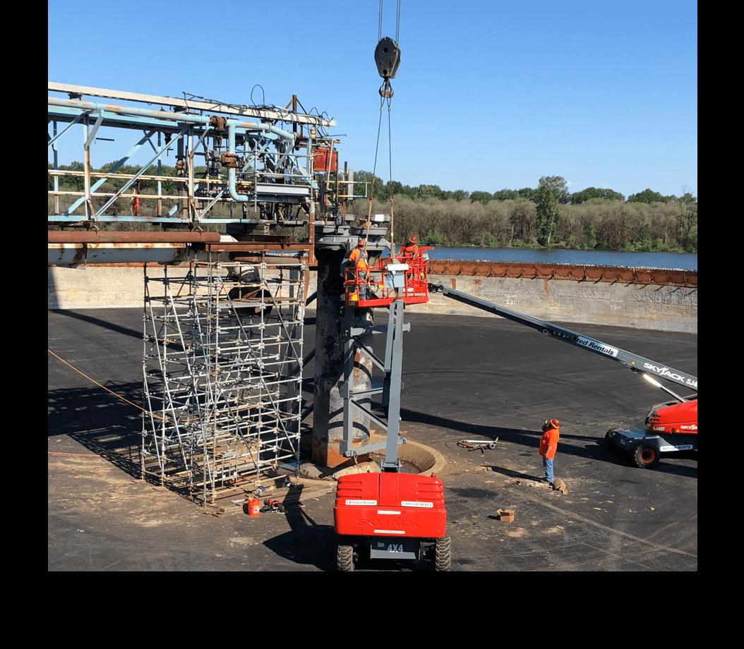 men building a water clarifier