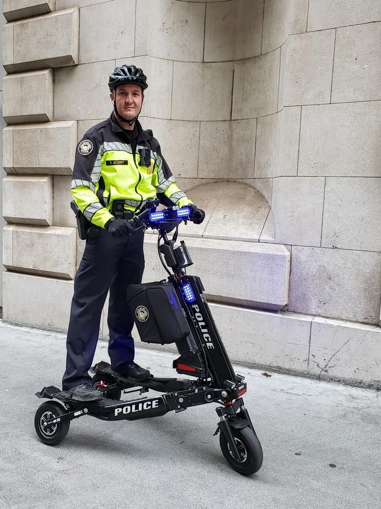 Officer on electric Trikke