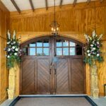 The restored handcrafted one-of-a-kind barn doors open to reveal your indoor event.
