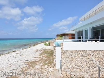 Step right onto the beach from the pool deck.