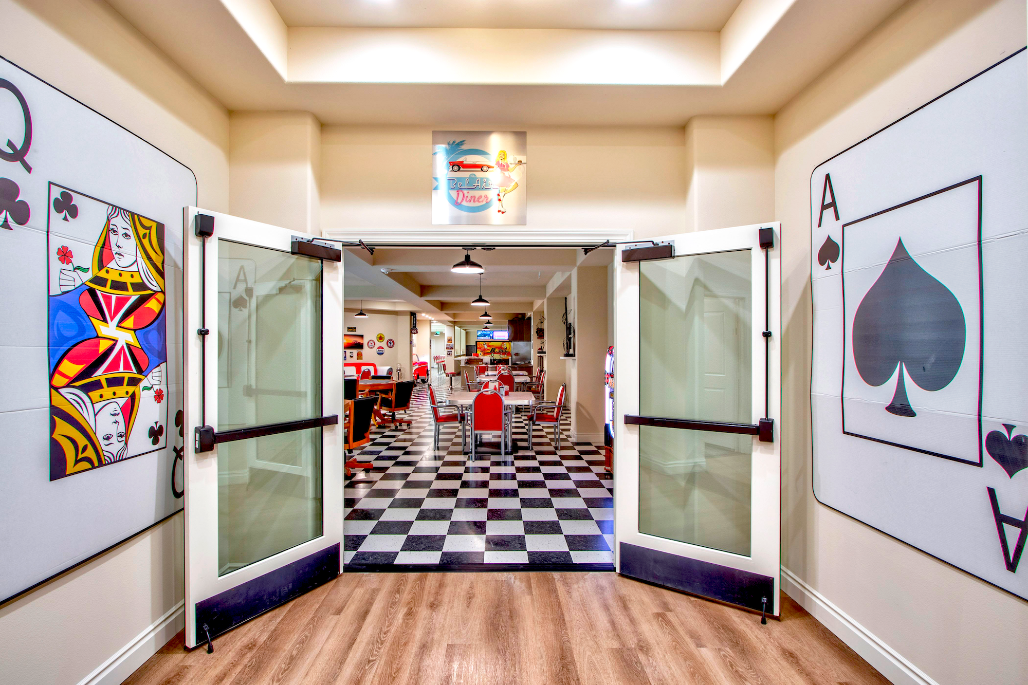 50s Inspired Diner Entrance. There are two oversized playing cards on the walls, looking into the dining area