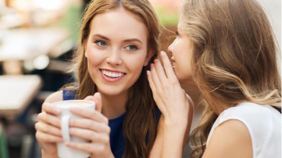 whispering women pic