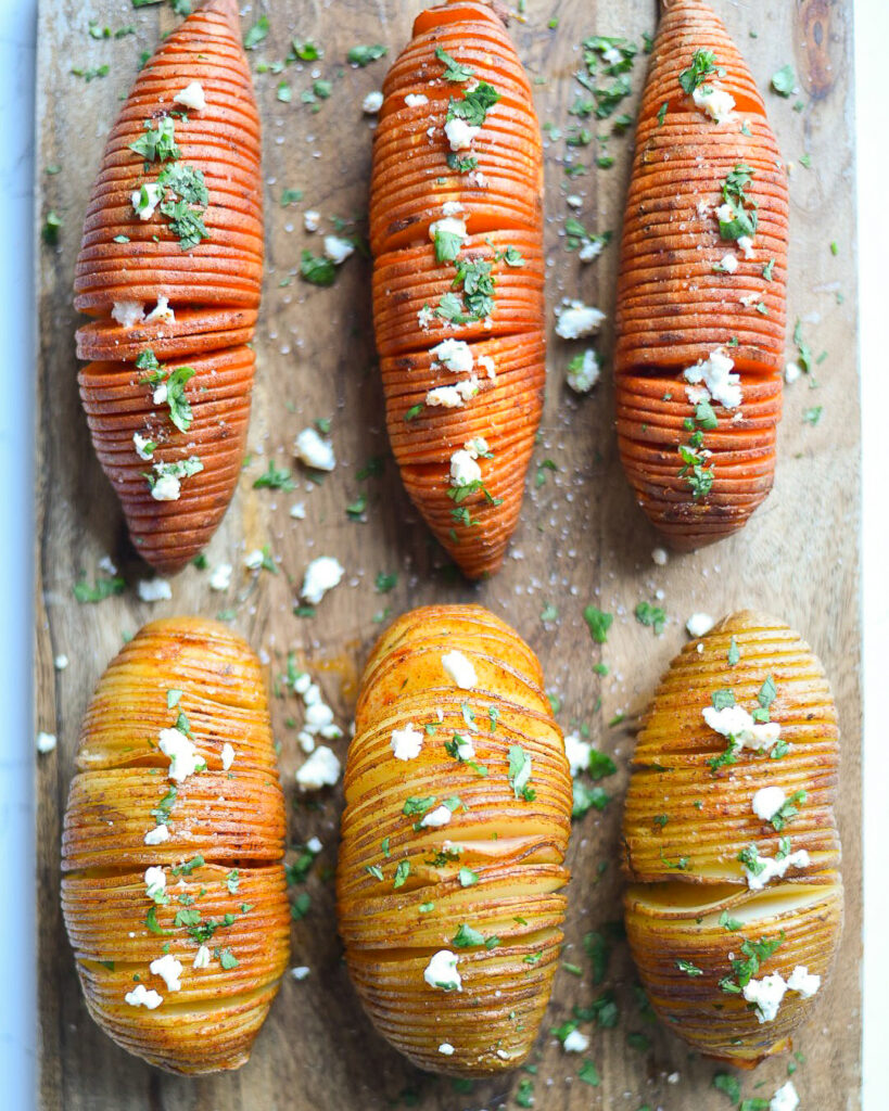 Six hasselback potatoes, sliced thinly with cheese and herbs.