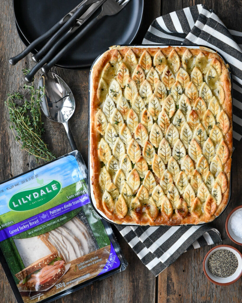 Turkey pot pie with leaf pattern crust and a package of Lilydale carved turkey breast.