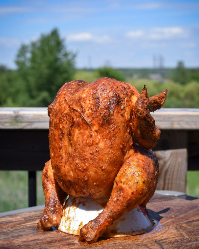 A finished beer can chicken with perfect crispy skin outside.