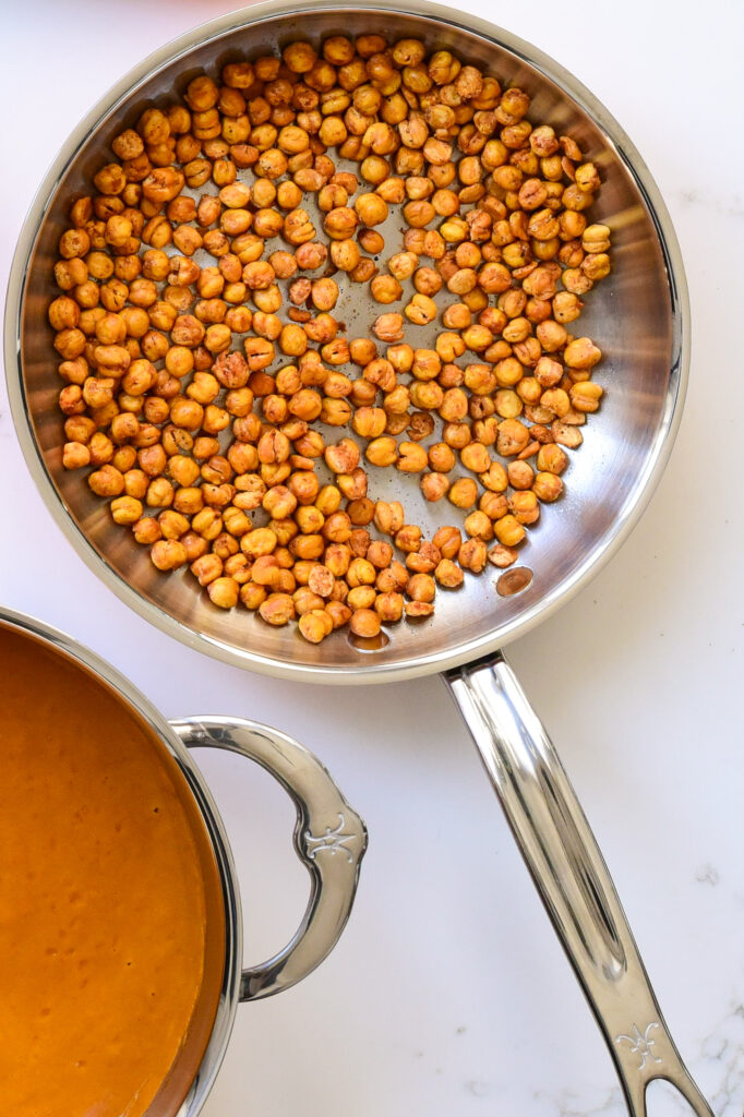 Top down image of a skillet with chickpeas.