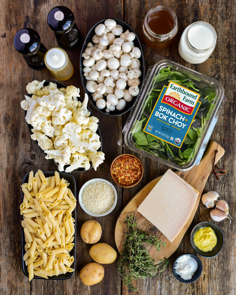 A top down view of ingredients for a cauliflower pasta.