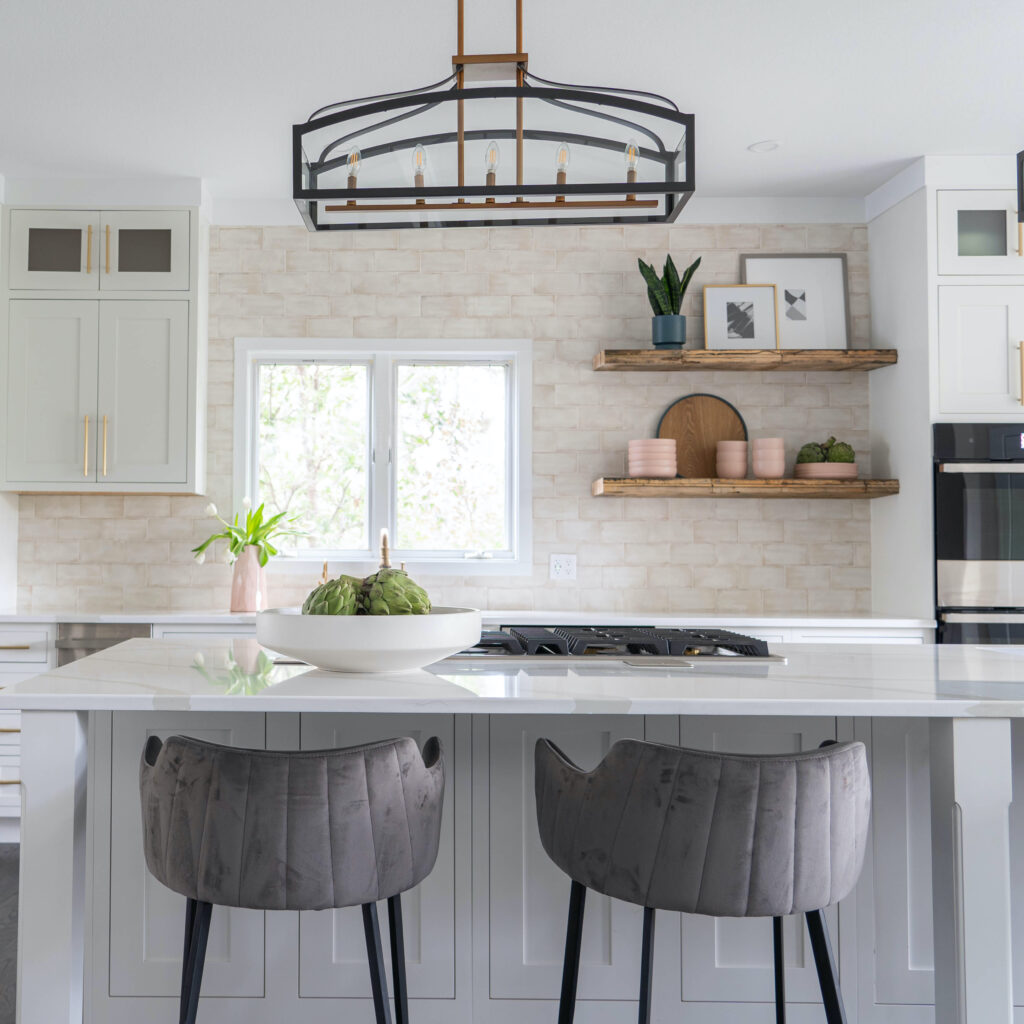 Kitchen vignette with island and grey stools