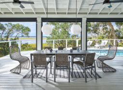 Outdoor table and chair set in front of a pool