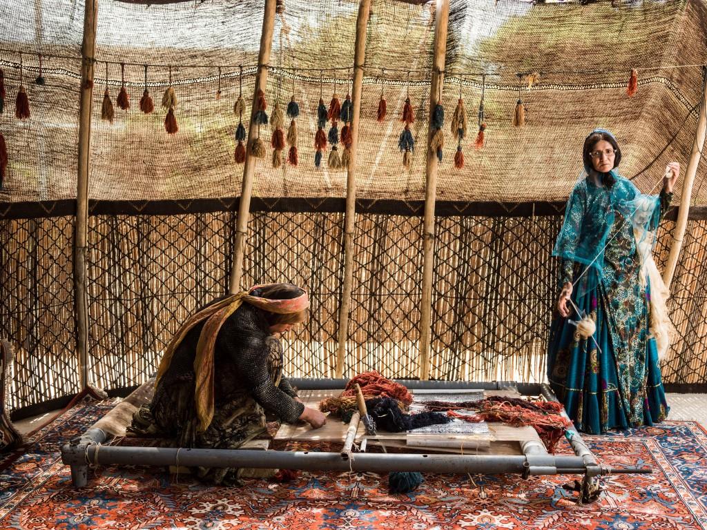 woman working rugs