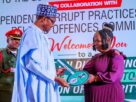 Buhari gifts house to honest airport worker