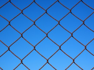 chain link fence against a blue sky