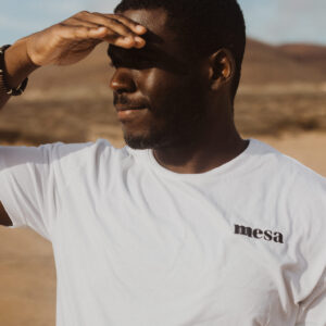 african american male in short sleeve white t shirt mesa logo