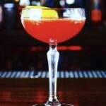 """Side Piece"" Our refined play on the Sidecar, with depth and red berry tones. cognac-amaro-curacao-strawberry-lemon"