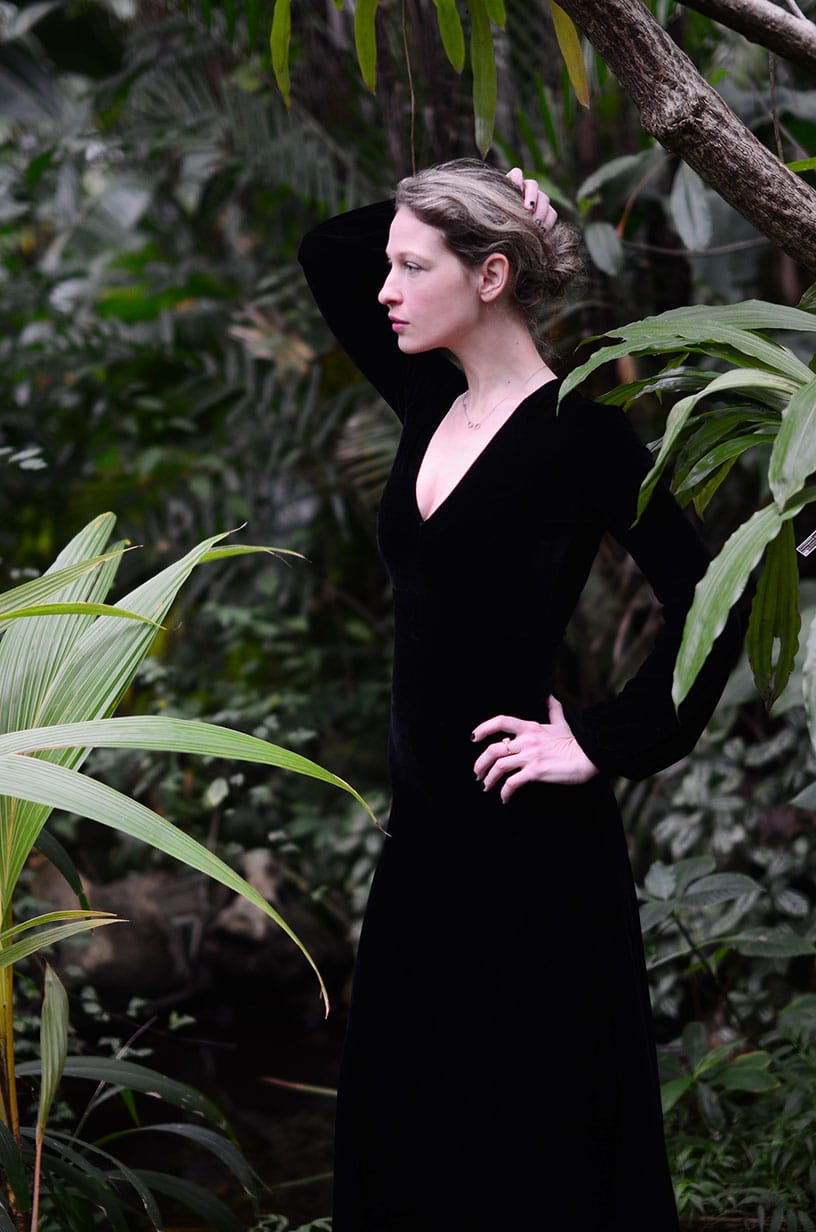 Wearing a black velvet evening gown at the botanical garden
