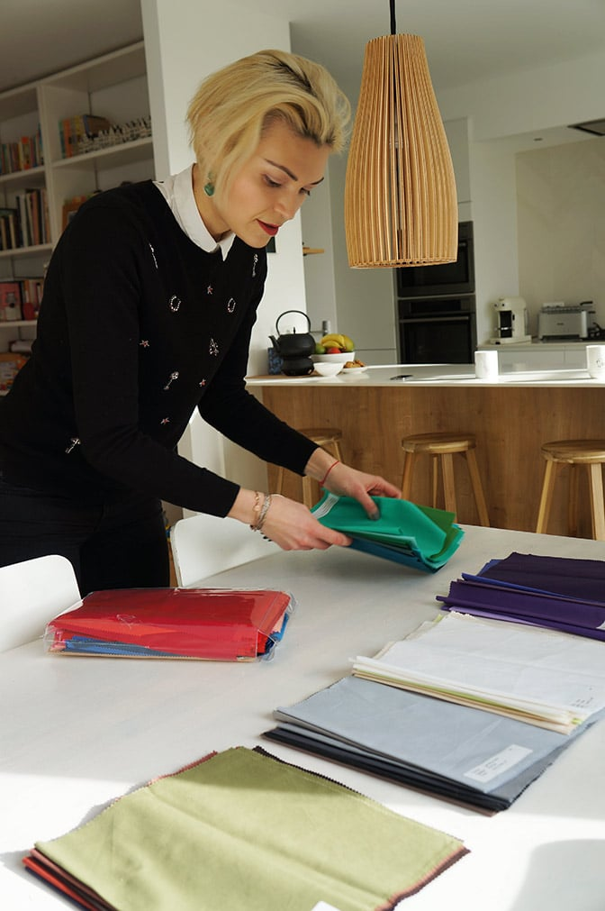 Anna, the personal shopper is laying out her color matching scarves