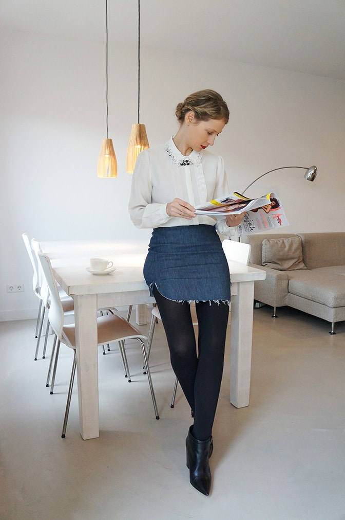 combining a vintage blouse with a modern denim skirt