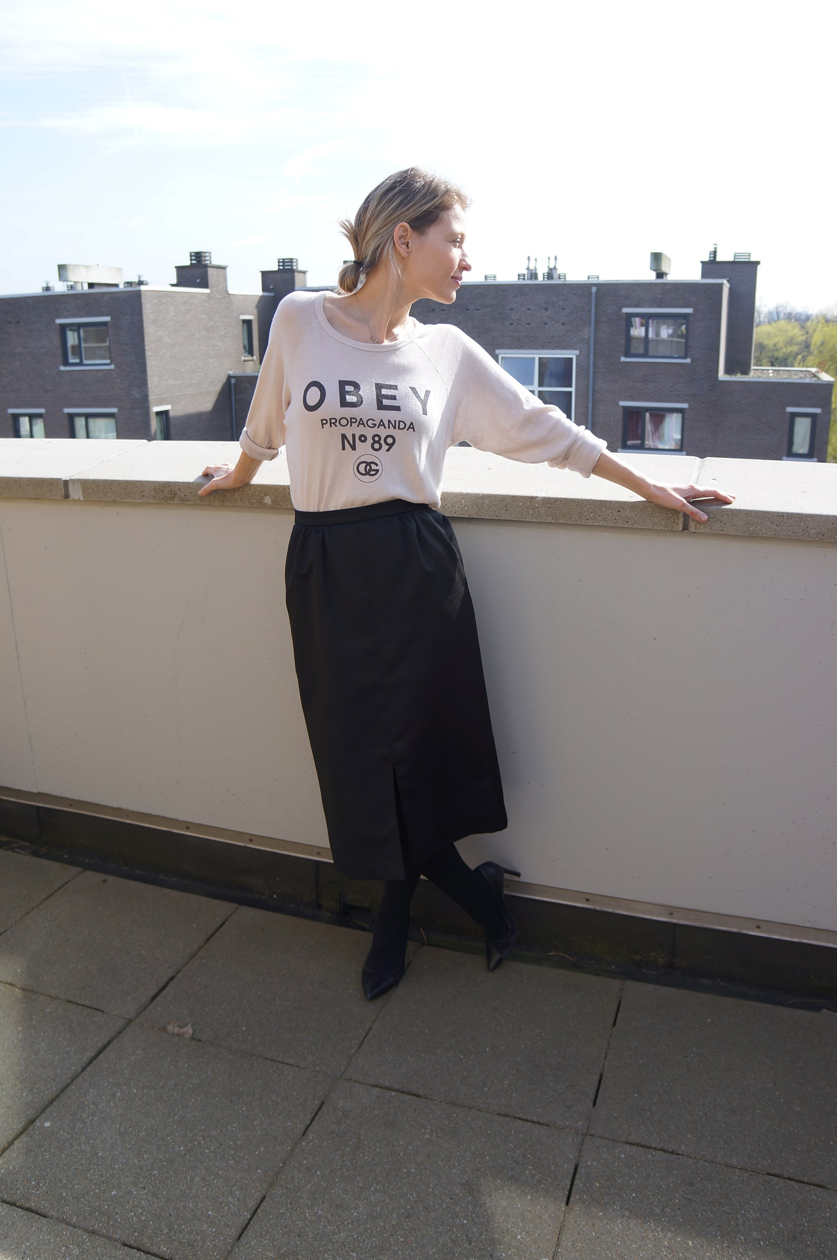 wearing an Obey sweater with a vintage pencil skirt
