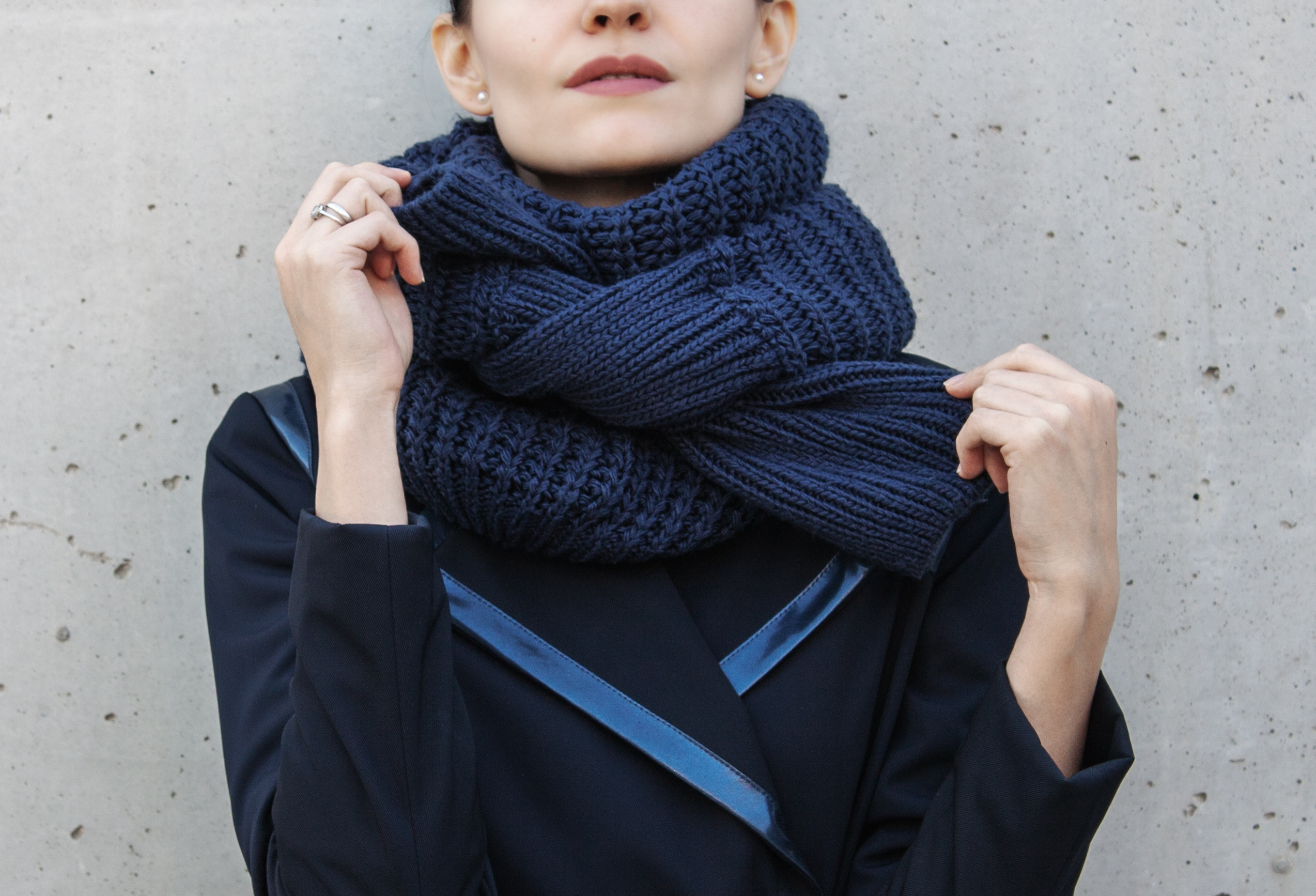 Elena Hilman showing how to tie s scarf out sweater