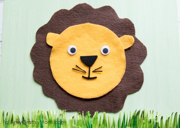 This image is of a lion head kids craft made from felt and wiggly eyes.