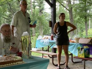 Friends President Carl Bujanowski presents Hayley with a card/gift from the Friends of MacKenzie.
