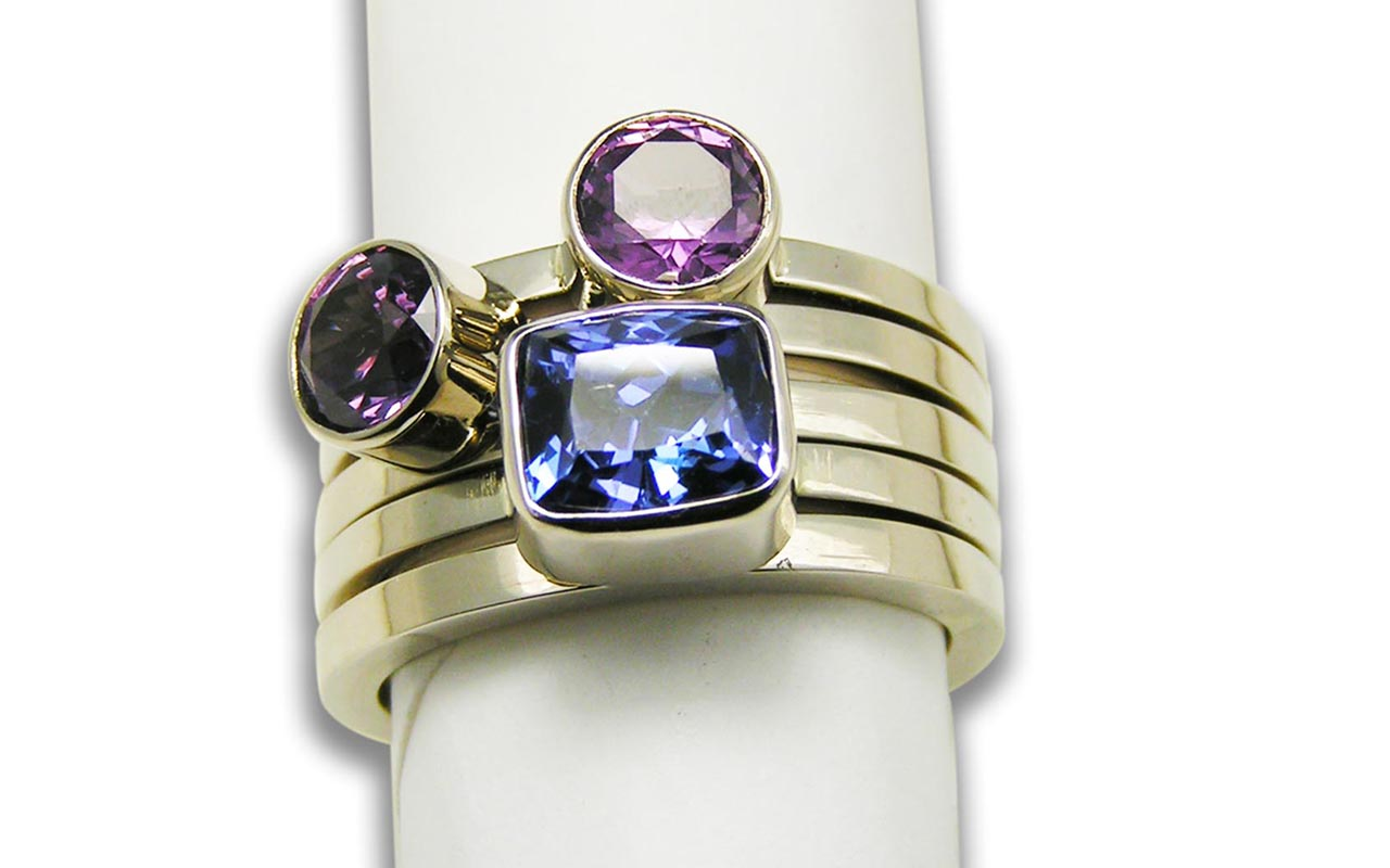 Stacker Rings - Tanzanite (blue, Amethyst (purple left), Pink Tourmaline with a plain spacer in 14kt white gold