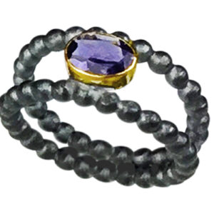 Yummy Bright Tanzanite - set in 22kt gold and heavy black oxidized silver.