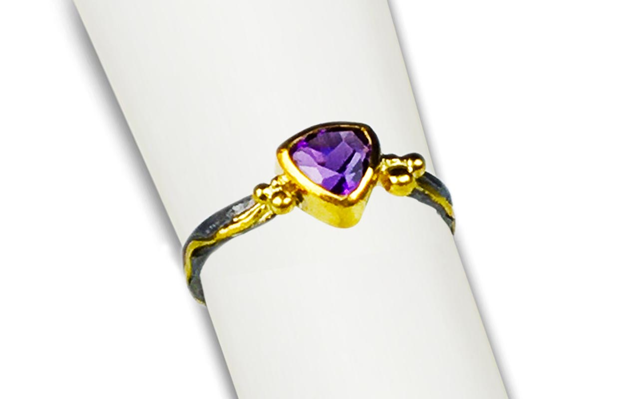 Trillion shape Amethyst set in 22kt gold and heavy black oxidized silver