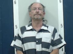 Grove Oak man charged for setting house on fire