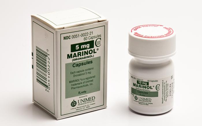 Development of a Therapeutic Respiratory THC Dry Powder Inhaler