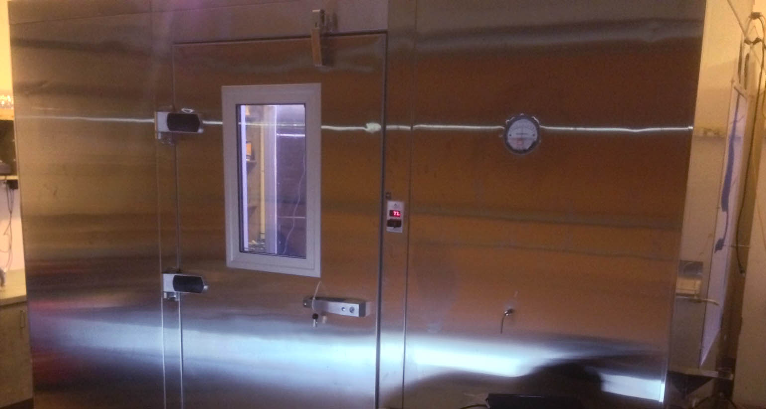 Biological Aerosol Decontamination Testing in a Sealed Room Environment